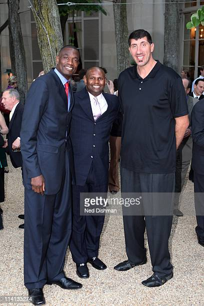 Legends Dikembe Mutombo Jared Jackson and George Muresan pose for a photo during the Sudan Sunrise Benefit at the Meridian International Center on...