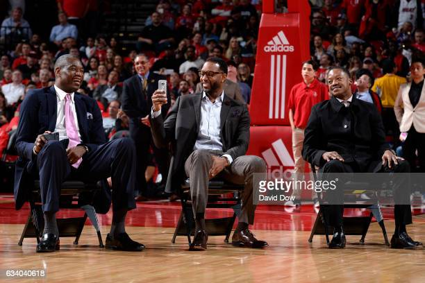 Legends Dikembe Mutumbo Tracy McGrady and Steve Francis look on during the Yao Ming jersey retirement ceremony during the Chicago Bulls game against...