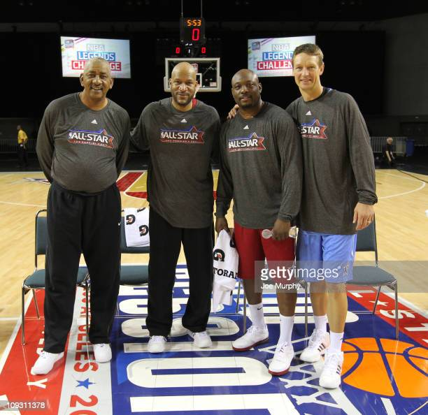 Legends George Gervin Ron Harper Mitch Ritchmond and Detlef Schrempf pose for a photo after the Legends Shootout on center court at Jam Session...