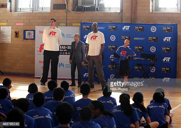 Legends Gheorge Muresan and Dikembe Mutombo participate in NBA Cares/FIT Day of Service at JHS 216 George J Ryan school during the 2015 NBA AllStar...