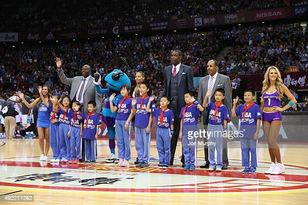 Legends Glen Rice Allison Feaster Dikembe Mutombo and Dell Curry stands for a NBA Cares moment in the game of the Los Angeles Clippers against the...