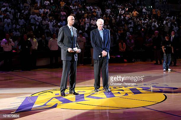 NBA legends Kareem AbdulJabbar and Bill Walton pause for a moment of silence to honor former UCLA head basketball coach John Wooden who passed away...