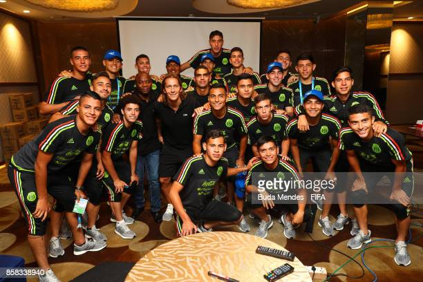 Legends Michel Salgado and Emmanuel Amunike pose for photographer with players of Mexico during a FIFA Ethics Workshop ahead of the FIFA U-17 World...