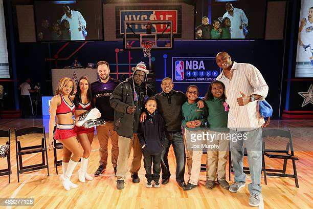 Legends Muggsy Bogues and Horace Grant pose with fans after playing Pictionary on BBVA Compass Center Court at NBA House at Moynihan Station during...