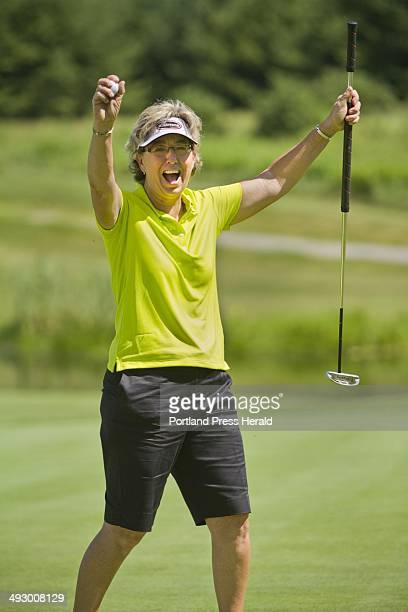 Legends tournament winner Sherri Turner celebrates after parring 18 to hold her lead at -6 at the Falmouth Country Club on Sunday, June 24, 2012 .