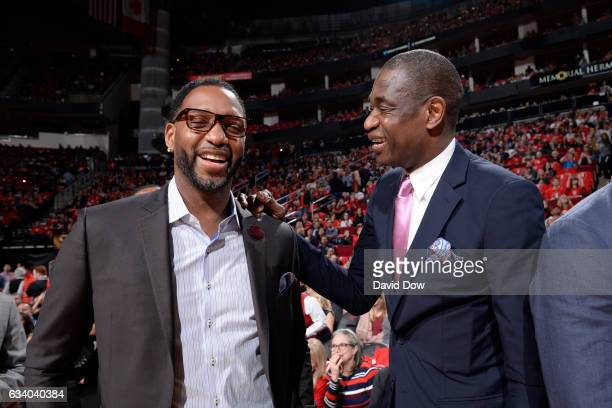 Legends Tracy McGrady and Dikembe Mutumbo speak during the Yao Ming jersey retirement ceremony during the Chicago Bulls game against the Houston...