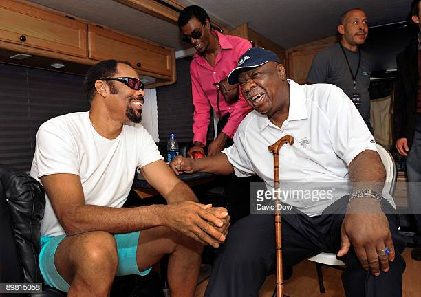 Legends Walt Clyde Frazier and Cal Ramsey share a moment at the Joe Joseph Abboud NBA Block Party on August 15 2009 in New York City NOTE TO USER...