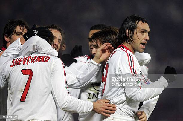 AC Milan players celebrate after the third goal scored by AC Milan's forward Andriy Shevchenko of Ukraine during their Italian serie A match against...
