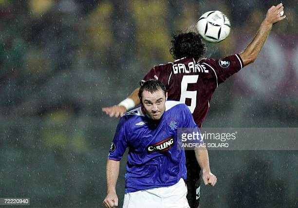 Glasgow Rangers 's midfielder Charles Adam fight for the ball with AS Livorno defender Antonio Galante during their UEFA football match 19 October...