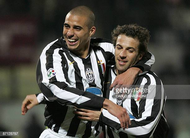 Juventus' forward David Trezeguet of France celebrates with his teammate forward and captain Alex Del Piero after scoring a goal during the italian...