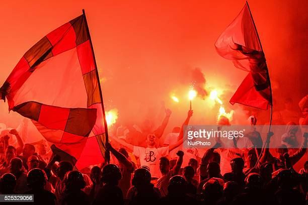 Legia fans cheer during the UEFA Europa League play-offs, first leg soccer match between Zorya Luhansk and Legia at the Dynamo stadium in Kiev,...