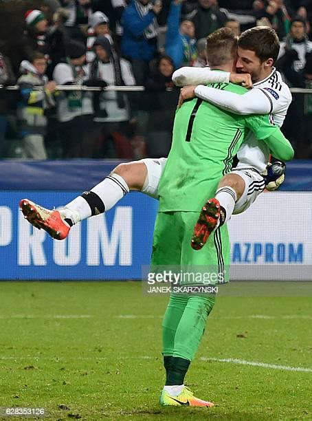 Legia Warsaw's Bartosz Bereszynski and his teammate goalkeeper Arkadiusz Malarz celebrate after Legia won the UEFA Champions League group F match...
