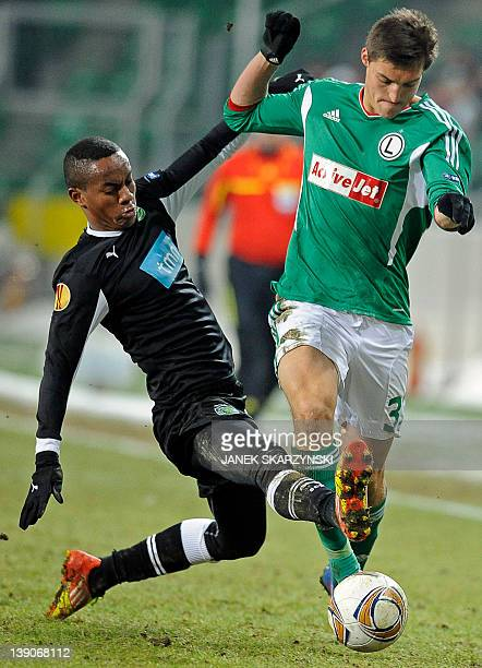 Legia Warsaw's Michal Zyro vies with Sporting Lisbon's Andre Carillo during their UEFA Europa League round of 16 football match in Warsaw on February...