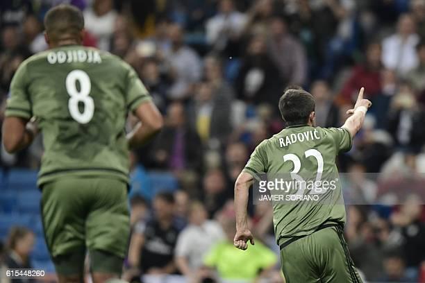 Legia Warszawa's Serbian midfielder Miroslav Radovic celebrates after scoring a goal during the UEFA Champions League football match Real Madrid CF...