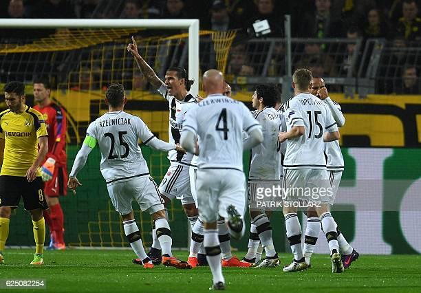 Legia´s Aleksandar Prijovic and his teammates celebrate his score during the Champions League football match between Borussia Dortmund and Legia...