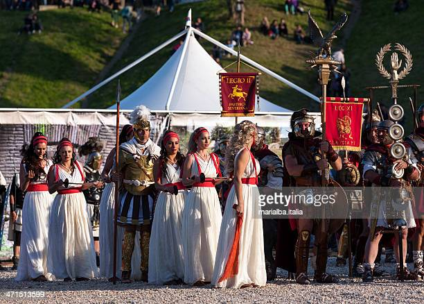 legionaries, mars and dancers - mars roman god stock photos and pictures