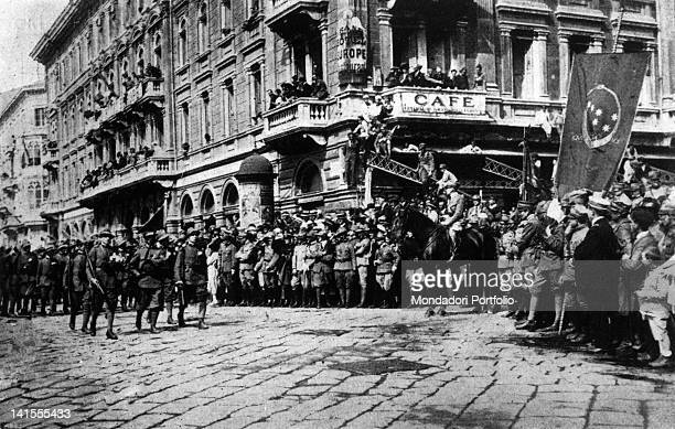 Legionaries parading past the crowd and the Italian poet and writer Gabriele D'Annunzio who is sitting on horseback Rijeka 1920