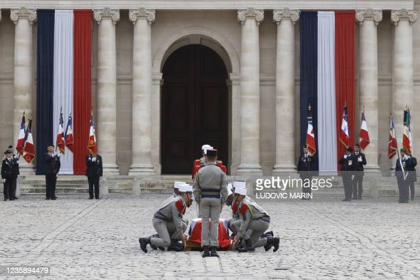 Legionnaires carry the coffin during a national memorial service for Hubert Germain - the last surviving Liberation companion - at The Hotel des...