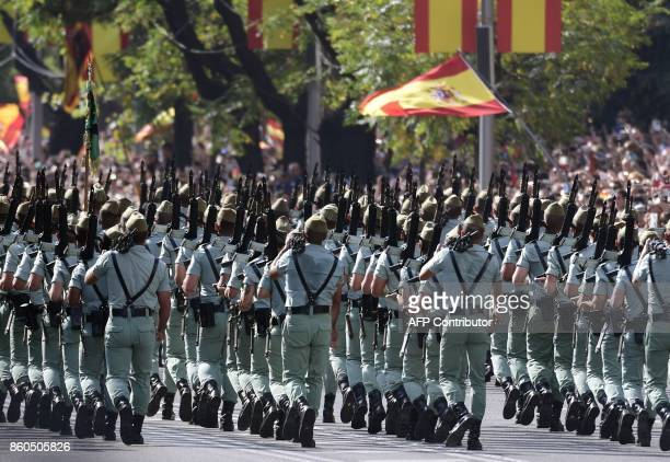 Legionnaires march during the Spanish National Day military parade in Madrid on October 12 2017 A Spanish Eurofighter jet crashed today after taking...