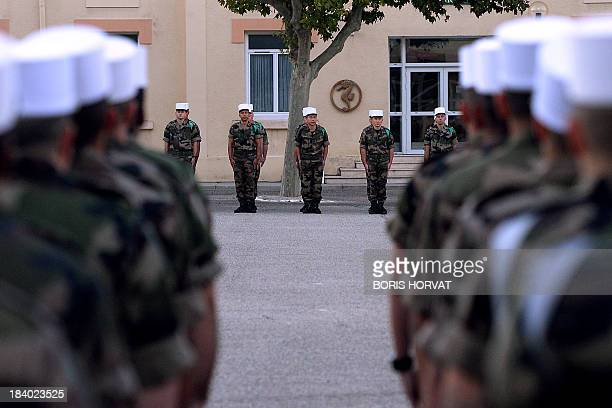 Legionnaires of the 1st Foreign Legion Regiment Cavalry Regiment 1er Regiment Etranger de Cavalerie take part on October 11 in the ceremony of the...