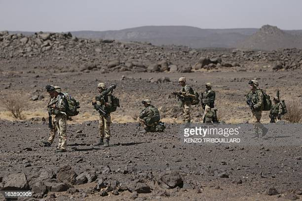 Legionnaires of the French army's 2nd Foreign Parachute Regiment are pictured during an operation in the Adrar of the Ifoghas mountains on March 17...