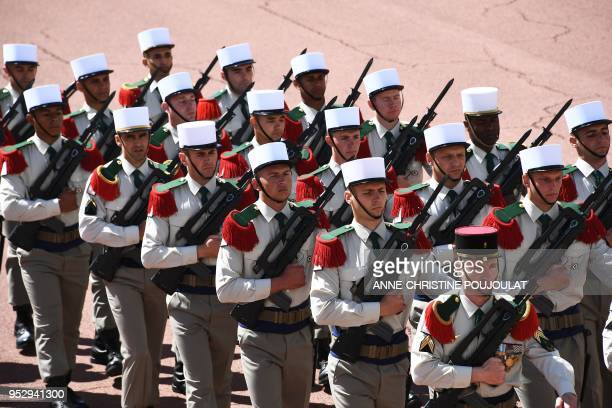 Legionnaires of the French Foreign Legion wearing their traditional white kepis parade during a ceremony to commemorate the 155th anniversary of the...