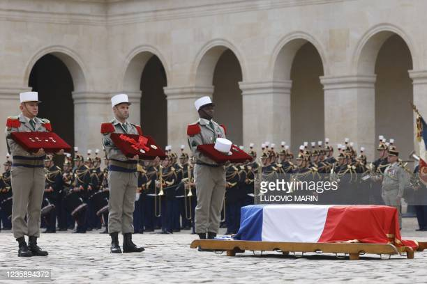 Legionnaires stand next to the coffin during a national memorial service for Hubert Germain - the last surviving Liberation companion - at The Hotel...