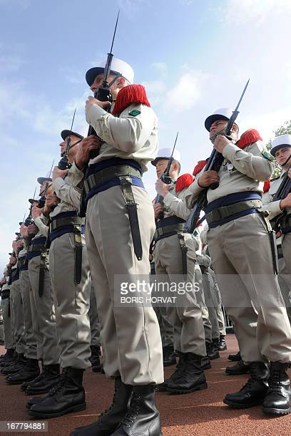 Legionnnaires of the French Foreign Legion wearing their traditional white kepis march on April 30 2013 in Aubagne to commemorate the 150th...
