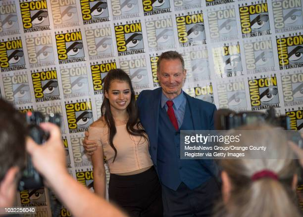 Legion's Amber Midthunder left and Bill Irwin pose for photos during ComicCon International at the San Diego Convention Center in San Diego CA on...