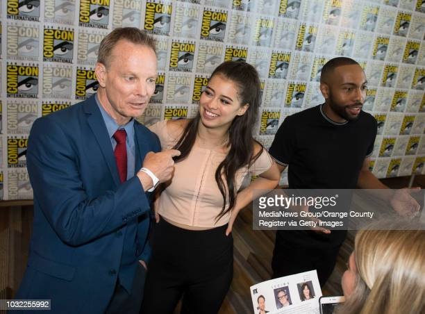 Legion's Bill Irwin and Amber Midthunder give interviews next to Jeremie Harris during ComicCon International at the San Diego Convention Center in...