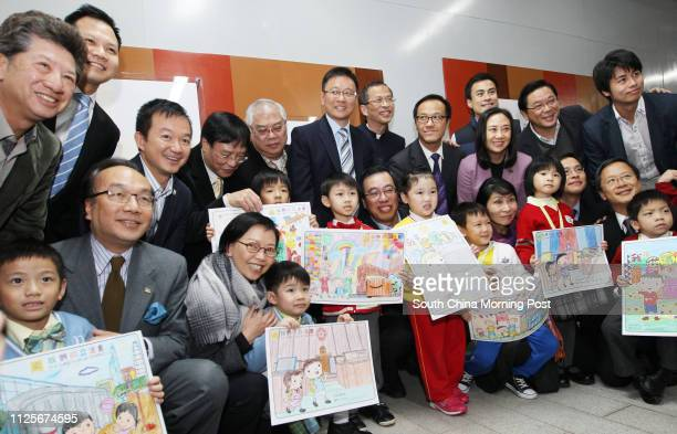 Legislative Council President Jasper Tsang Yoksing and his fellow lawmakers pose with kindergarten kids whose arts pieces featuring in an exhibition...