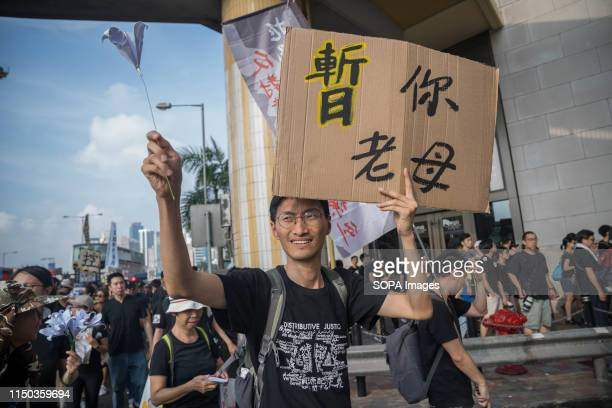 Legislative Councillor member Eddie Chu Hoidick seen holding a placard during the demonstration Despite the Chief Executive Carrie Lam's attempt to...