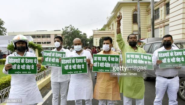 Legislators demonstrating with placards outside the Assembly durng the Monsoon Session on July 27, 2021 in Patna, India.