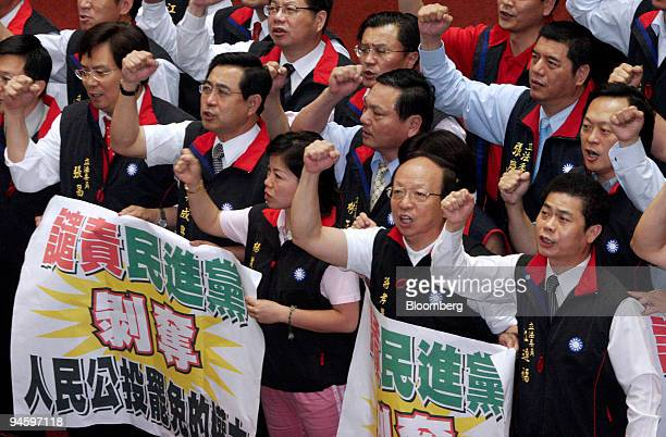 Legislators from the opposition Kuomintang and People First Party shout slogans during the session to recall Taiwan President Chen Shuibian in...