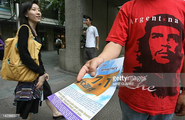 Legislators hand out leaflets to promote an upcoming protest rally in the central district of Hong Kong 20 June 2006 The organisers are hoping for a...