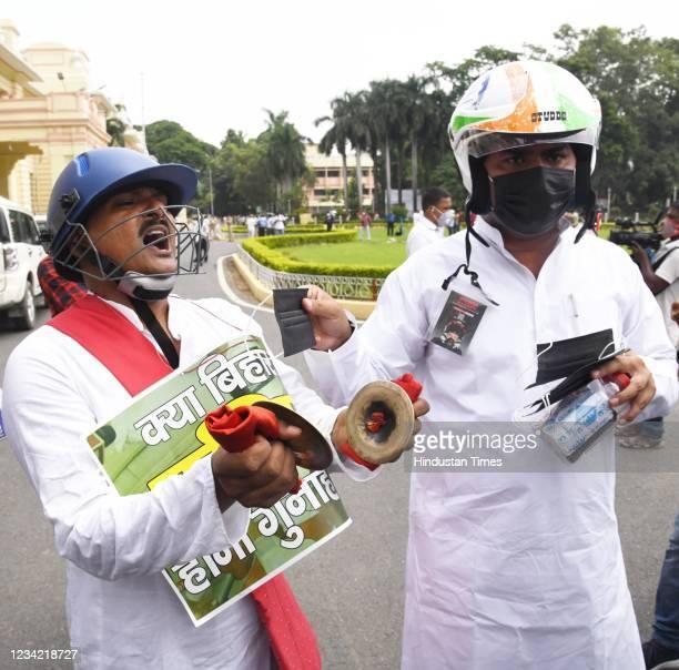 Legislators Satish Das and Mukesh Raushan demonstrating during Monsoon Session outside Bihar Assembly on July 26, 2021 in Patna, India.