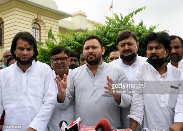 Legislators Tejashwi Yadav and Tej Pratap Yadav speak to the media outside the Assembly durng the Monsoon Session on July 27, 2021 in Patna, India.