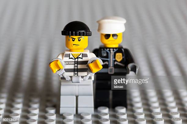Lego bandit arrested and handcuffed.