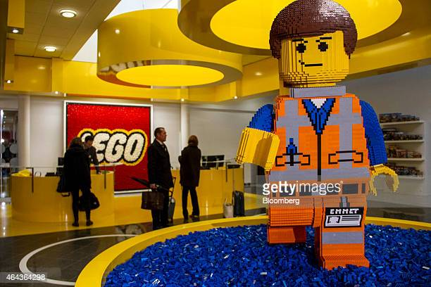 A Lego brick figurine of Emmet Brickowoski a character from 'The Lego Movie' stands in the reception area at the headquarters of Lego A/S in Billund...