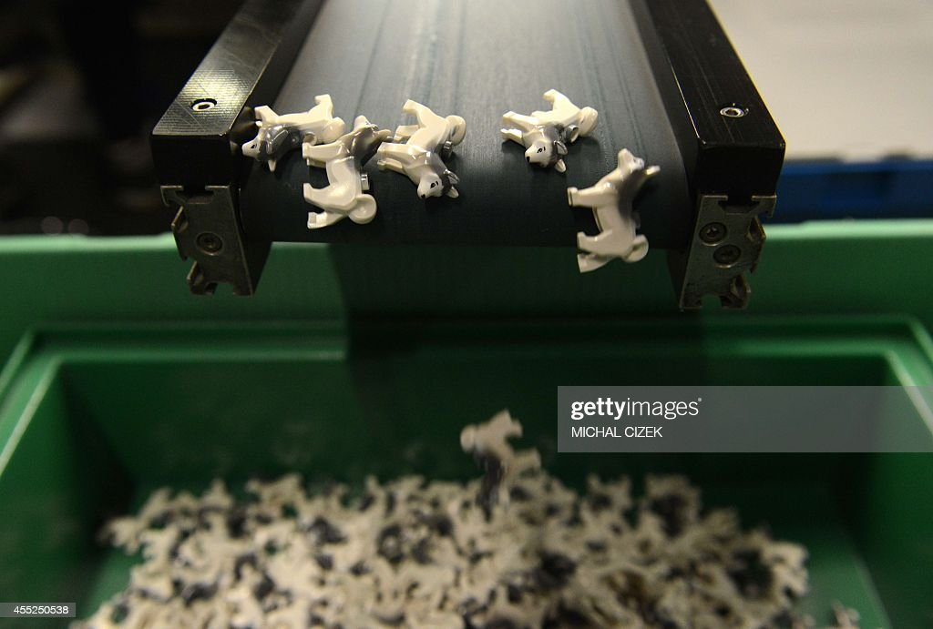 Lego bricks in the shape of Husky dogs leave the production line on September 11, 2014 in the Lego factory in Kladno city.