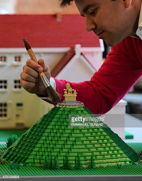 A Lego bricks replica of La Butte du Lion the main memorial monument of the Battle of Waterloo is prepared prior to the opening of the History in...
