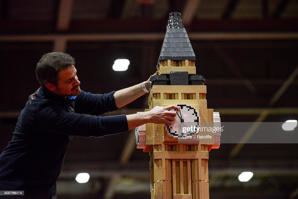 A Lego builder adjusts the clock on Big Ben made out of 30,000 bricks over 80 hours at ExCel on December 10, 2015 in London, England. Brick 2015 is an exhibition dedicated to Lego and runs at London's ExCel over three days starting on the 11th December. It features displays including Harry Potter, landmarks such as Big Ben and a dance music festival.