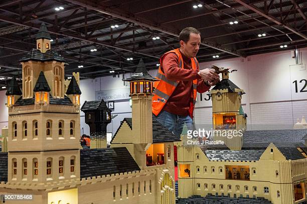 Lego builder Eric Philhan places a dragon on top of Hogwarts School from the Harry Potter series made out of 250000 bricks over 800 hours at ExCel on...
