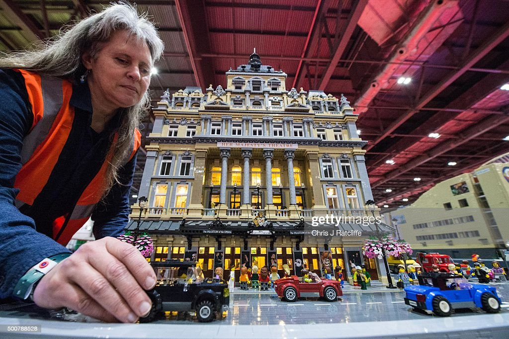 Lego builder Jessica Farrell finishes the street scence outside her Lego Her Majesties Theatre, with a performance of Phantom of the Opera taking place inside, made out of 57,992 bricks over 11 months at ExCel on December 10, 2015 in London, England. Brick 2015 is an exhibition dedicated to Lego and runs at London's ExCel over three days starting on the 11th December. It features displays including Harry Potter, landmarks such as Big Ben and a dance music festival.