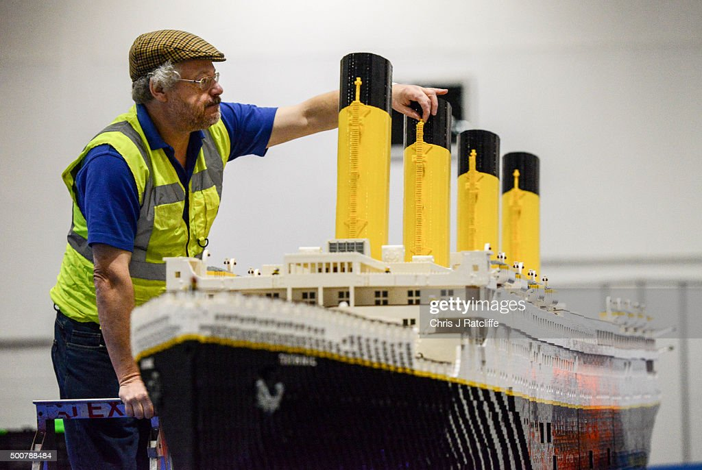 Lego builder Phil Traviss puts the finishing touches to his Titanic made out of 120,000 bricks over 3 months at ExCel on December 10, 2015 in London, England. Brick 2015 is an exhibition dedicated to Lego and runs at London's ExCel over three days starting on the 11th December. It features displays including Harry Potter, landmarks such as Big Ben and a dance music festival.