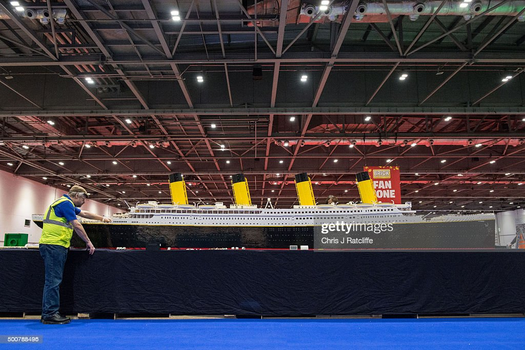 Lego builders Phil Traviss and Annie Diment put the finishing touches to their Lego Titanic, made of 120,000 bricks over 3 months at ExCel on December 10, 2015 in London, England. Brick 2015 is an exhibition dedicated to Lego and runs at London's ExCel over three days starting on the 11th December. It features displays including Harry Potter, landmarks such as Big Ben and a dance music festival.