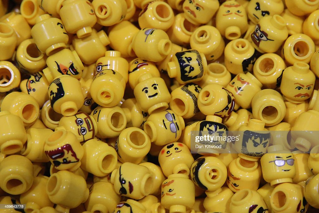 Lego figure heads are displayed on the opening day of BRICK 2014 at the Excel Centre on November 27, 2014 in London, England. The four day event showcases creations by some of the world's best Lego builders and runs until November 30th.