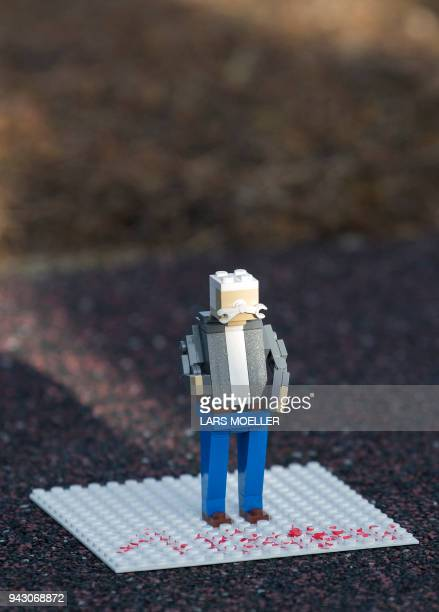 A lego figure representing Lech Walesa former Polish President and former leader of the Independent Polish Trade Union Solidarity can be seen as he...