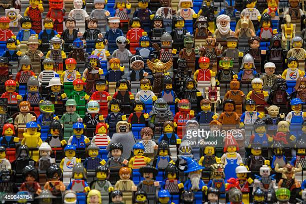 Lego figures are displayed on the opening day of BRICK 2014 at the Excel Centre on November 27 2014 in London England The four day event showcases...