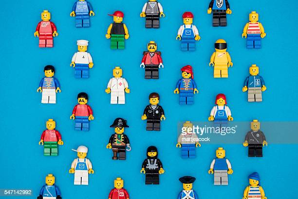 lego figures background - lego stock photos and pictures